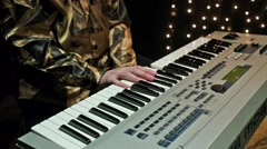 Keyboard player is playing in studio with garlands. Stock Footage