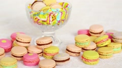 Colorful cookies with cream on table and in glass vase. Stock Footage