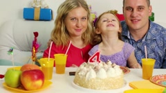 Little girl is making a face at the birthday table. Stock Footage