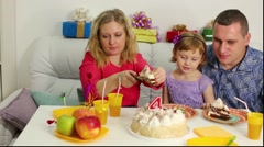 Little girl is taking a piece of the birthday cake. Stock Footage