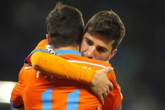 Jose Gaya embraces Pablo Piatti of Valencia CF - stock photo