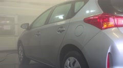 The gray clean auto Toyota is staying in car wash service. - stock footage
