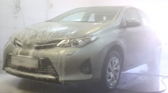 Worker is cleaning car Toyota after soap in carwash service Stock Footage