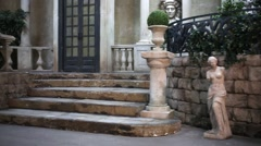 Old house inner courtyard with sculptures and columns. Stock Footage
