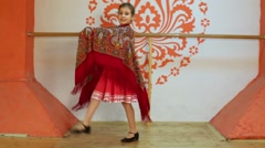Smiling girl in red folk costume dances with shawl at stage. Stock Footage