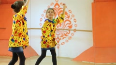 Little girl dressed as jester dances on stage against mirror. Stock Footage