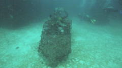 Scuba divers exploring artificial reef Stock Footage