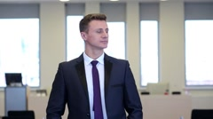 Stock Video Footage of Man dressed in suit stands hands to his trousers pockets