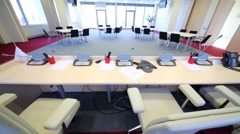 Spacious bright conference room with four tables Stock Footage