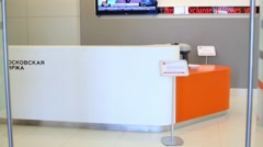 White reception desk and monitors in office Moscow Exchange. Stock Footage