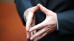 Gesticulating hands of old man dressed in costume. Stock Footage