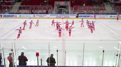 Figure skaters performance before games of hockey Stock Footage