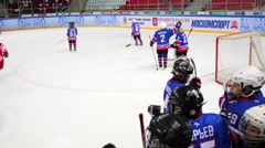 Children hockey teams on ice and behind board Stock Footage
