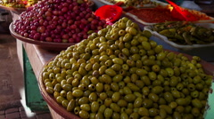 Handheld shot of olives on display in a souk in Marrakesh Stock Footage