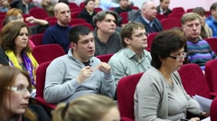 Young man from audience asks at general meeting Stock Footage