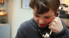 Boy talks on old phone in Museum of phone  Stock Footage