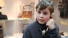 Boy talks on phone in Museum of phone in Preobrazhenskoe district Stock Footage