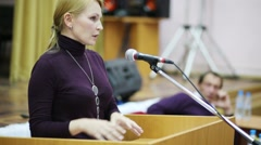 CFO Kukhareva Natalia at rostrum at general meeting of homeowners Stock Footage