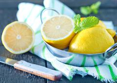 lemons in metal bowl on a table - stock photo