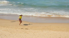 Attractive surfer runs towards sea Stock Footage