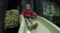 Children playing on slide at life science museum Stock Footage