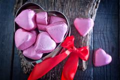 chocolate candy on the wooden table, chocolate hearts - stock photo