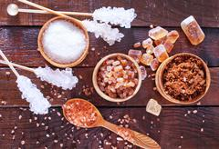 Stock Photo of reed and white sugar on the wooden table
