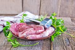 Raw meat with spice on a table Stock Photos