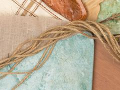 tile, fabric and twine - stock photo
