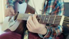 man playing acoustic guitar slow motion - stock footage