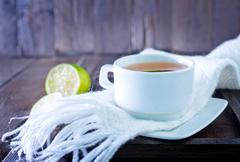 Fresh tea with lemon in the cup Stock Photos
