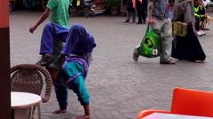 Handheld shot of a street acrobat at the Jamaa el Fna in Marrakesh Stock Footage
