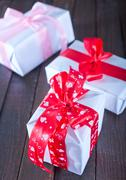 boxes for present  with ribbon on a table - stock photo