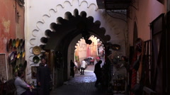 Handheld shot of an alley in the medina quarter of Marrakesh Stock Footage
