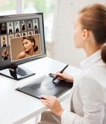 Female retoucher working at home or office Stock Photos
