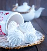 meringues in bowl on a table - stock photo