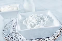 cheese,milk and sour cream in bowl and on a table - stock photo