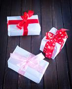 Boxes for present  with ribbon on a table Stock Photos