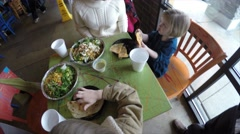 A family eating at a mexican restaurant Stock Footage