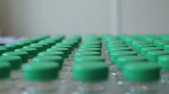 Many water bottles with green lids - stock footage