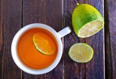 tea with lemon on wooden table - stock photo