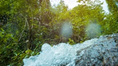Stock Video Footage of Water Splashing over Rocks in a Natural Spring in Thailand