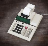 Stock Photo of Old calculator showing a text