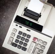 Old calculator showing a percentage - 70 percent Stock Photos
