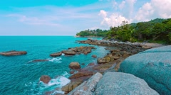 Calm Tropical Sea on Rocky Beach in Thailand Stock Footage