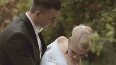 Groom tips bride and kisses her on the neck Stock Footage