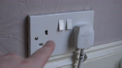 4k switching a plug on at home UK electrical sockets Stock Footage