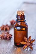 Anise oil in bottle and on a table Stock Photos