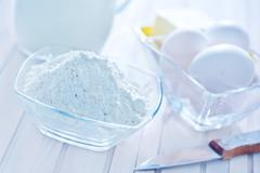 ingredients for dough on the white table - stock photo
