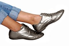 Stock Photo of sport silver footwear and womens foots